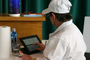 Each judge uses an Ipad to send the data to be tabulated and recorded.