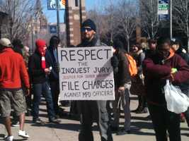 Family and friends of Derek Williams rally on the corner 16th Street and Wisconsin Avenue after a special prosecutor who ruled over the case released his report Friday explaining his decision on why he chose not to file charges against three police officers involved.