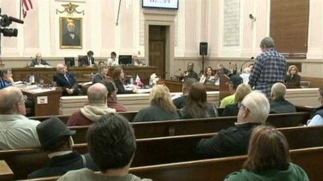 Vote passed allowing elected officials to carry weapons in city hall.
