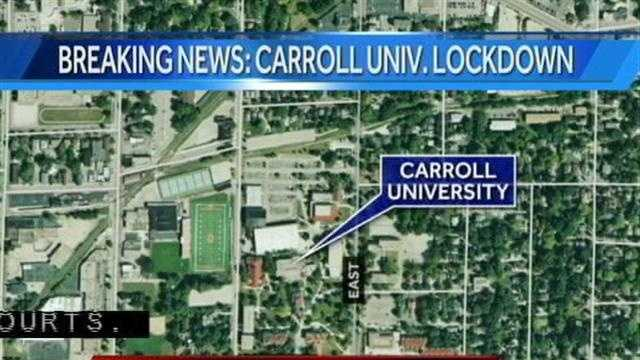 """Students and staff at Carroll University are being asked to stay indoors after two students reported a person with a """"long gun"""" near the tennis courts on campus."""