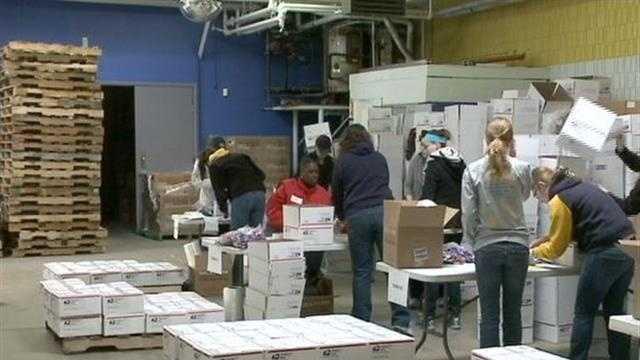 Volunteers work to build food supply
