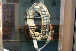 1930's Catchers mask with spit opening.  Due to the amount of players chewing tobacco, the spit opening was added.  Other innovations included reinforced steel cage and added padding inside.