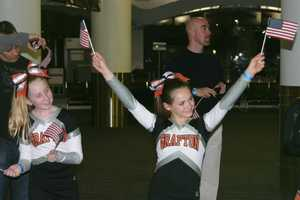 Grafton cheerleaders were some of the first smiling faces the vets saw when they arrived in Milwaukee.
