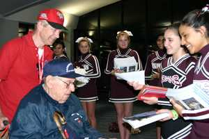 Menomonee Falls cheerleaders were on hand to welcome home the vets and pass out books and thank you cards.