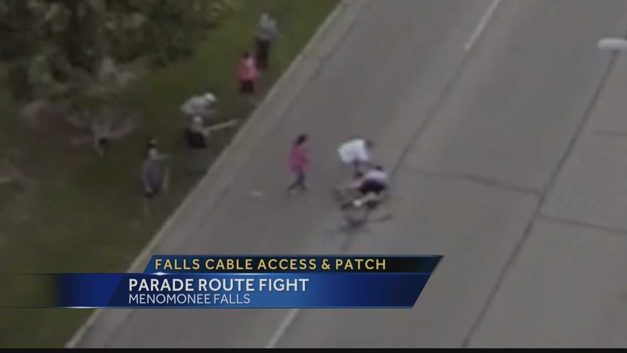 Falls Cable Access catches this fight on camera. Two men fight over a parade spot.