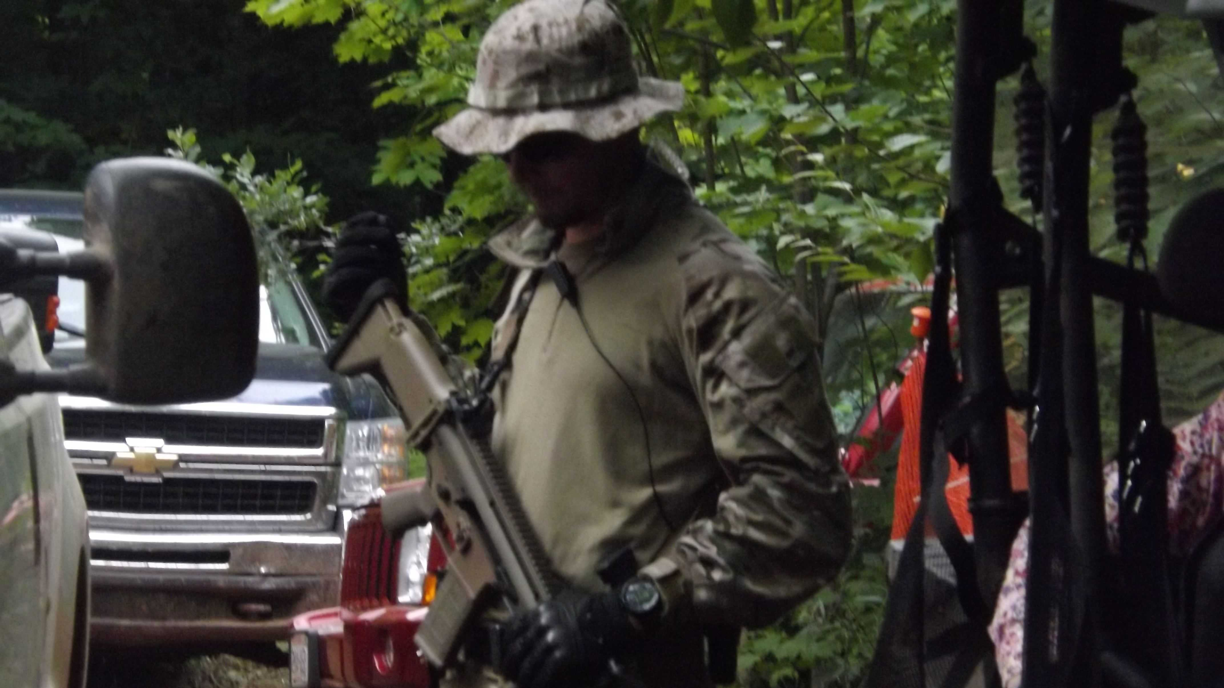 An armed guard from Bulletproof Securities of Arizona provides security at the Gogebic Taconite mine site near Mellen, Wis.