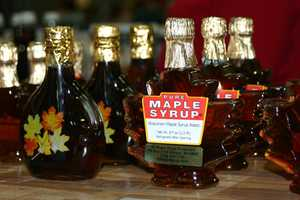 Pure Wisconsin maple syrup available for purchase.