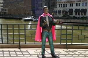 The Bronze Fonz is just one of the ten statues around town that is wearing a pink cape.
