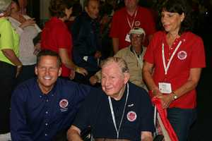 Joe Dean, Stars and Stripes Honor Flight founder, poses with a vet.