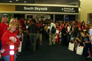 Typically the airport is packed with well-wishers.