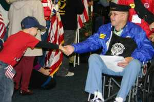 Veterans with light blue jackets are Korean War vets.