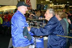 "Harvey Kurz (right), star of ""Honor Flight"" the movie, welcomes home the vets at the airport."