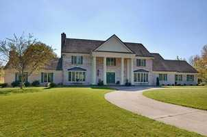 Built on five acres of land, this house has more than 5,300 square feet of living space. This colonial, built in 1980, has a marble foyer and grand staircase. It also includes a gourmet kitchen. For more information on this property, click here.