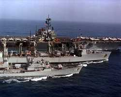 The fourth USS Milwaukee (pictured center servicing the USS Forrestal in 1988) was decommissioned in 1994.
