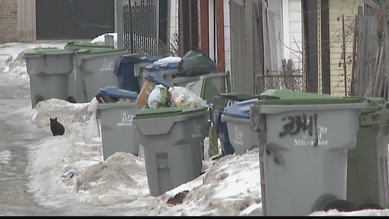 DPW workers robbed in alley