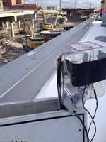 A camera keeps watch on the progress of the nearby demolition.
