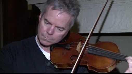 Almond plays violin