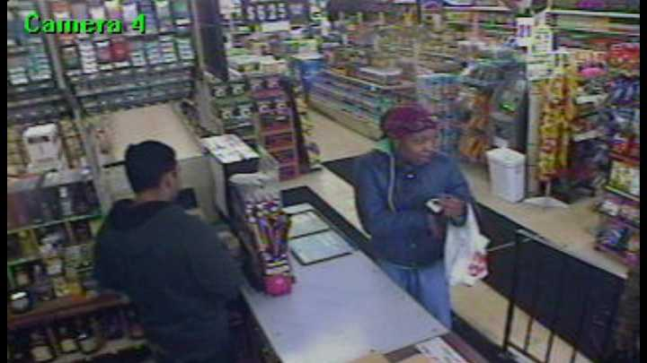 Surveillance - woman using credit card