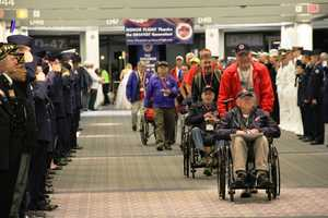 When the vets return home they are first greeted by active duty military and distinguished guests before making their way to the public homecoming.