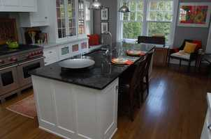 The custom-designed kitchen is a recent renovation to the home.