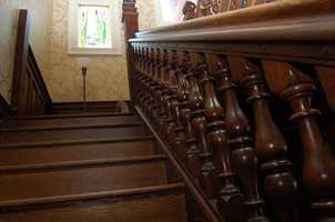 The home, built in 1901, had this grand staircase removed in the 1940s when the home was split into a two-family dwelling.