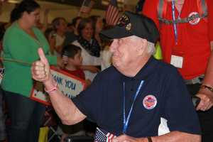 The 22nd Stars and Stripes Honor Flight returned to a big cheering crowd on June 7, 2014.