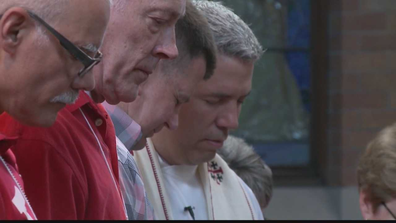 Same sex newlyweds' marriages blessed at Milwaukee church service.