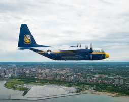 "The C-130 affectionately known as ""Fat Albert"" and assigned to U.S. Navy flight demonstration Squadron, the Blue Angels, is flown over Lake Michigan off the coast of Milwaukee for a scheduled team photo shoot. The Blue Angels are scheduled to fly in 68 performances at 35 locations this year."