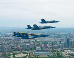 Pilots assigned the U.S. Navy flight demonstration Squadron, the Blue Angels, fly their F/A-18s in the Delta formation over Lake Michigan off the coast of Chicago for a scheduled team photo shoot. The Blue Angels are scheduled to fly in 68 performances at 35 locations this year.