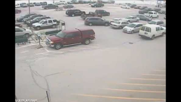 Surveillance Video: Van crashes into several vehicles in parking lot