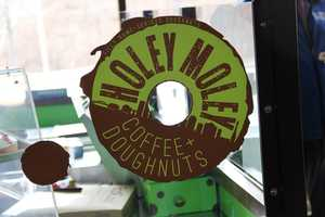 "Not pictured... ""Hella Nuttela""- Nutella, banana, hazelnuts and frozen custard inside a glazed doughnut."