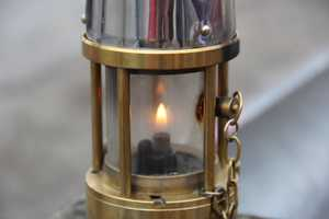 This is flame they keep lit and use to light the torches, it originated in Greece. just like all Olympic flames.