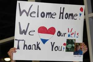 Welcome home signs were in full force on Saturday for the latest Honor Flight homecoming celebration.