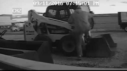 thief getting on Bobcat