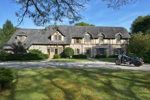 Built by Walter Davidson Jr. in 1940, this classic home is set on nearly 13 acres and features beautiful living spaces, natural fireplaces, original details, remarkable craftsmanship and the first known motorcycle garage built for a fine home.