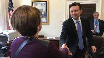 Kathy Mykleby meets White House Press Secretary Josh Earnest in advance of her interview with President Obama.
