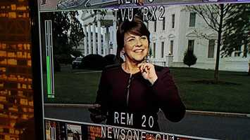 "After the interview, Kathy Mykleby heads to ""pebble beach,"" the area outside the White House where reporters present their stories. This view is from the video feed into the WISN 12 newsroom."