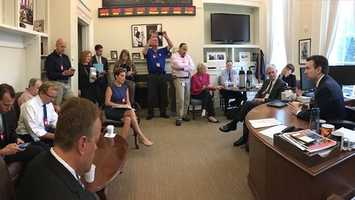White House Press Secretary Josh Earnest holds a briefing with invited reporters in his office.