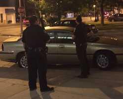 Officers armed with shotguns stood guard as Mayor Tom Barrett and Common Council President Ashanti Hamilton spoke at midnight.
