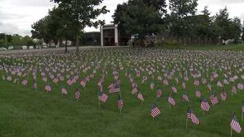 Greenfield firefighters placed nearly 3,000 flags at the Greenfield Police Department, representing those who died on Sept. 11, 2001.