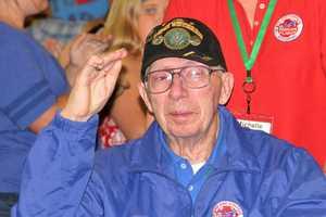 Light blue shirts/jackets denote Korean War vets.