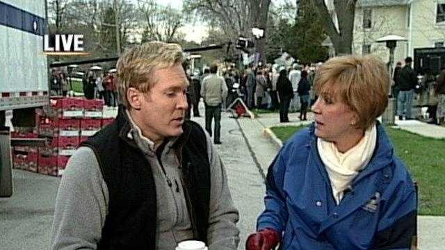 Sam Champion with WeatherWatch 12 meteorologist Sally Severson during a visit to Waukesha in 2009.