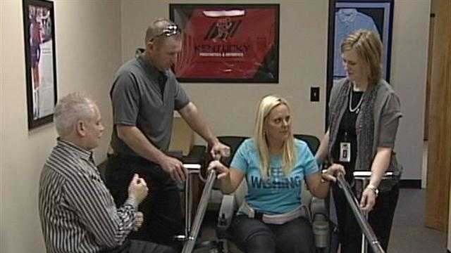 Mom who lost legs during tornado takes first steps