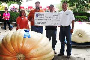 The winner of the Kentucky State Fair largest pumpkin contest topped the scale at 1,074.5 pounds. James and John Van Hook of Somerset grew the winner and plan to harvest the seed and use them to grow another prize winner for next year's Fair.
