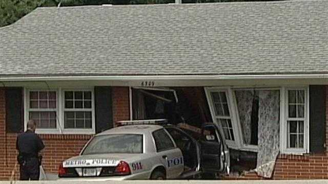 911 calls released after police car crashes into home