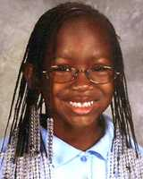 """Tiaj Richelle Ethelyn Smith was last seen on August 10, 2009 in Gary Indiana. Her nickname is Aji and she may be in the company of her father in the Bahamas. At the time of her disappearance, Tiaj was 3'5"""" and 70 lbs. She wears glasses as seen in this photo and today she is 11 years old."""