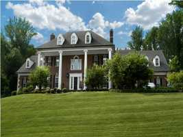The home has 6 bedrooms and 9 bathrooms. It site on 2.96 acres of Kentucky's finest land. It also features a 4 car garage, a swimming pool, and a renovated basement.