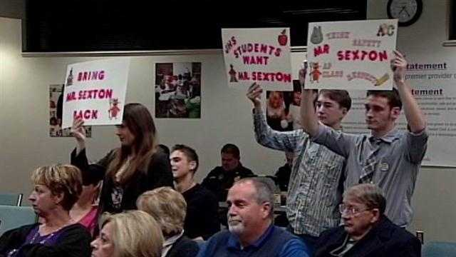 Students support principal at school board meeting
