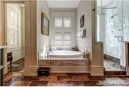 Exquisite marble bathroom tub and shower in the master bathroom suite.