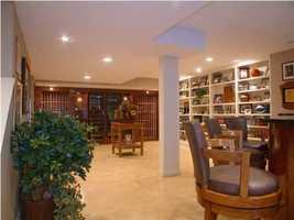 Recently remodeled walk-out lower level is great for entertaining with a beautiful full bar and wine cellar